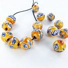 Ceramic beads round 12mm orange with flowers